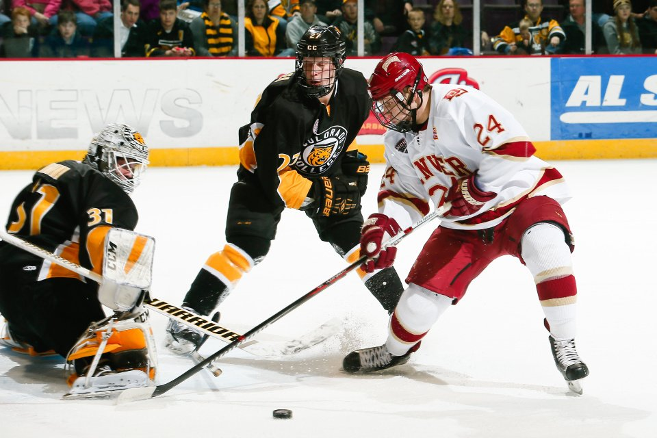 Denver freshman forward Colin Staub, of Colorado Springs, CO (shown here tormenting Colorado College), scored the first two goals of the game en route to his team's 5-2 win over Michigan Tech in Cincinnati, OH, today.  Denver advanced to play the winner of the late game today between Union College and Pennsylvania State University, tomorrow at 3:00PM on ESPNU.