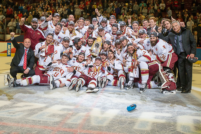 The Denver team mugs for the group shot Saturday night after beating Minnesota Duluth 3-2, winning the 2017 NCAA Championship Game in Chicago.